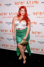 Hunter McGrady donned a silver corset top for the upper half of her 'Little Mermaid' costume during Heidi Klum's Halloween party.