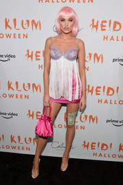 Elsa Hosk looked flirty in a fringed top while attending Heidi Klum's Halloween party as Natalie Portman's character in 'Closer.'