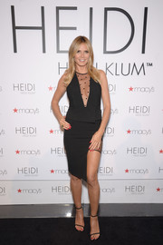 Heidi Klum captivated in a black Mason by Michelle Mason peplum top with a cleavage-flaunting dotted panel during her lingerie ice cream truck and shopping party.