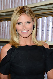 Heidi Klum launched the Clear Scalp and Hair Beauty Therapy brand with her luxe locks looking shining and healthy.