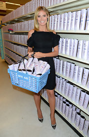 Heidi Klum launched Clear Scalp and Hair Beauty wearing a pair of sexy two tone heels.