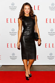 Michelle Bridges chose a fitted black leather dress for a sleek and sexy red carpet look.