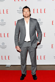 Sam Worthington traded in his action-hero duds in favor of this slick and dapper silver suit.