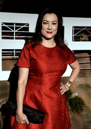 Jennifer Tilly amped up the glam factor with layers of gemstone and gold bracelets.