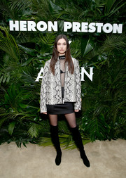 Jacquelyn Jablonski teamed an oversized snakeskin-print jacket with a sheer top and a mini skirt for the Heron Preston + Tequila Avion dance party.