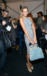 Petra Nemcova was spotted backstage at the Herve Leger fashion show carrying a retro-chic blue Prada bowler bag.