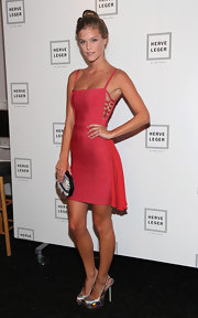 Nina Agdal styled her pink bandage dress with silver platform slingbacks.