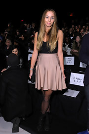 Harley donned a pale pink high-waisted skirt with a godets for the Herve Leger fashion show.