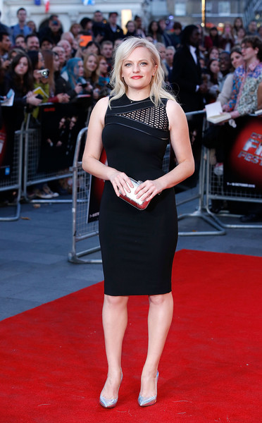 Elisabeth Moss injected more shine with a metallic silver clutch.