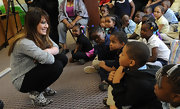 Hilary Duff chatted with students during the Blessings in a Backpack program wearing black and white Sigerson Morrison printed calf hair boots.