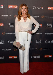 Connie Britton finished off her ensemble with a chain-embellished nude leather clutch.