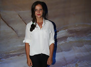 Laura Robson posed for a portrait at the Hobart International tournament wearing a basic white button-down and black jeans.