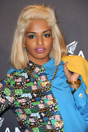 M.I.A. amped up her stylish look with bleach blond shoulder length locks.
