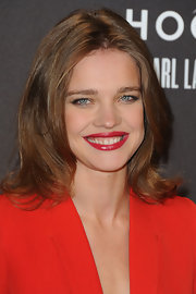 Natalie Vodianova attended Paris fashion week wearing polished red lipstick.