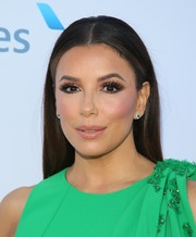 Eva Longoria matched her green dress with a pair of emerald studs.