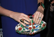 Demi went ultra glam and carried this gemstone inlaid clutch that was full of color and personality.