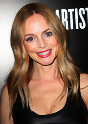 Heather Graham showed her pearly whites with bright pink lips and dewy cheeks at a gala in Hollywood.