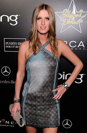 Nicky Hilton added a dark touch to her look with glamorous nail polish.