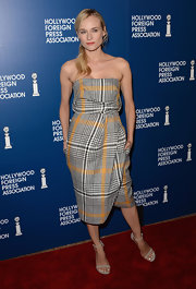 Diane opted for classic elegance by wearing this gray and gold plaid strapless dress.