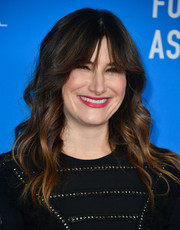 Kathryn Hahn wore her hair in loose waves with eye-grazing bangs at the HFPA Grants Banquet.