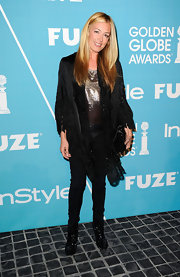 Cat Deeley topped off her red carpet look with sequined black ankle boots.