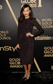 Ashley Madekwe was one classy lady in this long-sleeve print dress at the Golden Globe award season celebration.