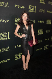Karla Souza looked fierce in a Mason by Michelle Mason deep-V black leather top at the Golden Globe Award season celebration.