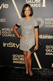 Garcelle looked cute and on-trend in this leather-clad silver mini-dress at the Golden Globe award season celebration.