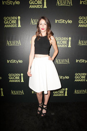 For a more feminine finish, Amanda Crew wore a flared white skirt with her crop-top.