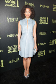 Sticking to a monochromatic theme, Gugu Mbatha-Raw accessorized with a pale-blue hard-case clutch.
