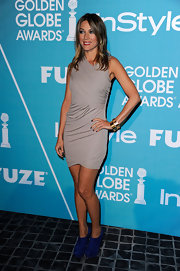 Natalie Zea topped off her draped dress with cobalt blue suede ankle boots.
