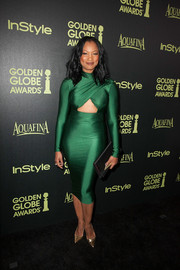 Garcelle Beauvais complemented her sultry dress with a lip-embellished satin clutch by Diane von Furstenberg.