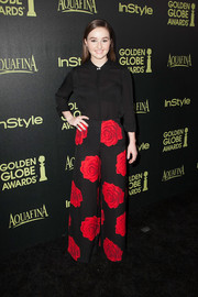 Kaitlyn Dever punched up her plain black blouse with a pair of wide-leg pants boasting a bold floral print.