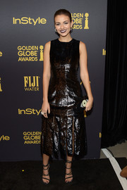 Victoria Justice was edgy-chic in a shiny black carwash-hem dress by Mathieu Mirano at the HFPA and InStyle Golden Globe Award season celebration.