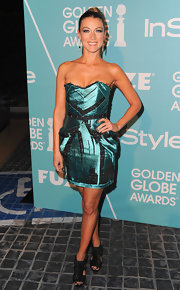 Natalie Zea looked futuristic in black cutout boots. She paired the trendy heels with a strapless metallic dress.