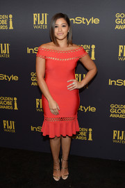 Gina Rodriguez went the flirty route in a body-con red off-the-shoulder dress by Hervé Léger at the HFPA and InStyle Golden Globe Award season celebration.