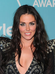 Taylor Cole showed off her long brunette curls while hitting the 'InStyle' event.