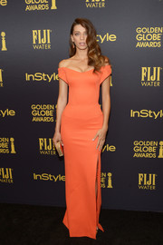 Angela Sarafyan got glammed up in an orange off-the-shoulder gown for the HFPA and InStyle Golden Globe Award season celebration.