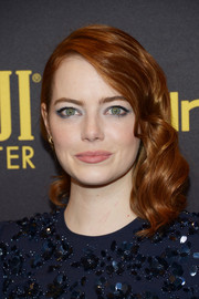 Emma Stone polished off her look with blue-lined eyes.