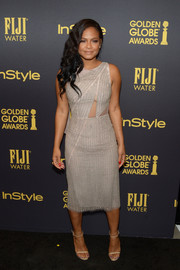 Christina Milian was seductive, as usual, at the HFPA and InStyle Golden Globe Award season celebration in this micro-beaded taupe dress with peekaboo detailing.