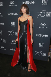 Nina Dobrev looked vampy in a red and black slip gown by Ralph Lauren at the Golden Globes 25th anniversary celebration.