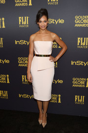 Cynthia Addai-Robinson styled her dress with pointy gold pumps.