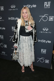 Abbie Cornish arrived for the Golden Globes 75th anniversary celebration wearing a button-embellished blazer by Tory Burch.
