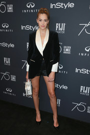 Sistine Rose Stallone attended the Golden Globes 75th anniversary celebration wearing a black velvet blazer with contrast satin lapels and cuffs.