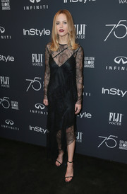 Halston Sage brought plenty of allure to the Golden Globes 75th anniversary celebration with this black lace midi dress by Manning Cartell.