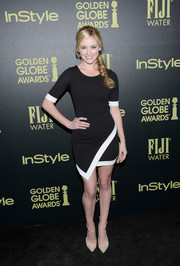 Gree Grammer wore an asymmetrical black above-the-knee dress with white piping along the sleeves and hemline for a modern look.