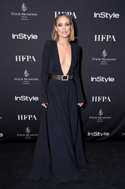 Olivia Wilde was the definition of sultry elegance in this deep-V black gown by Alexandre Vauthier Couture at the 2018 HFPA and InStyle TIFF celebration.