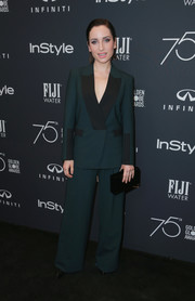 Zoe Lister Jones went the menswear-chic route in a green and black Dion Lee suit at the Golden Globes 75th anniversary celebration.