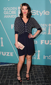 Mary looked adorable in black Maryjane pumps. She paired the heels with a red pedicure for a perfectly darling look.