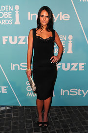 Jordana Brewster added an exotic element to her look with a feathered clutch.